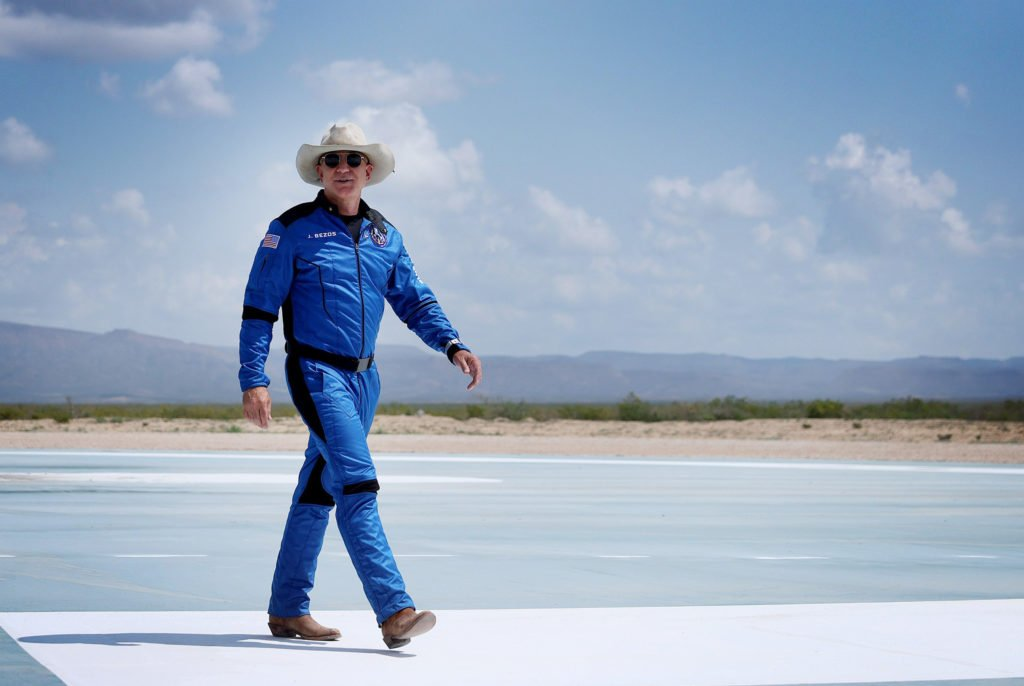 VAN HORN, TEXAS - JULY 20: Jeff Bezos walks near Blue Origin's New Shepard after flying into space on July 20, 2021 in Van Horn, Texas. Mr. Bezos and the crew that flew with him were the first human spaceflight for the company. (Photo by Joe Raedle/Getty Images)
